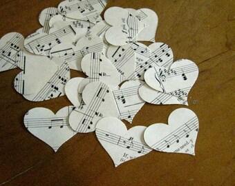 100 die cut vintage sheet music paper hearts; vintage paper confetti