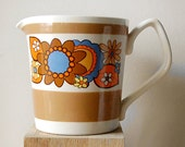 Vintage Retro Hippie Flower Power 1970s Ceramic Mustard Yellow Measuring Cup for Kitchen Use.