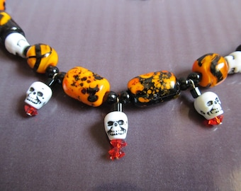 halloween lamp glass and skull necklace