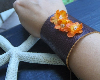 The Hibiscus Gypsy Wrist Cuff  Leather Bracelet . Victorian corsette style Leather laced cuff. Orange silk flowers embellished