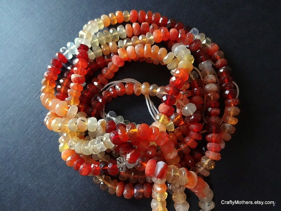 """NEW STOCK - AAA Mexican Fire Opal Microfaceted Rondelles, 4.5mm - 4.5"""" strand"""