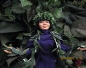 Hawaiian dancer with maile lei and royal purple holoku