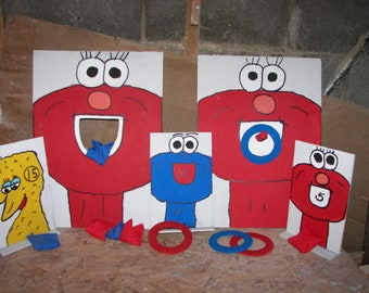 Elmo      ring and bean and set of 3 knock overs