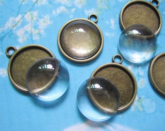 10pcs 22mm antiqued bronze round picture/photo frame charms/pendants with 10pcsmatching clear glass cabochons