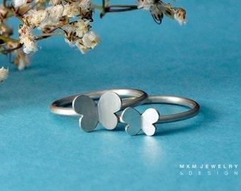 Double Butterfly Rings