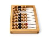 Back to school. Vintage wooden abacus, brown