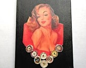 Pin-Up on Black Canvas with Hand Crafted Paper Beads,  Assemblage Art, Mixed Miedia Collage