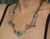 Countess Marjoram Handmade RePurposed Elegant Steampunk Antique and Vintage Blue Lens Gold Wings Bead and Chain Necklace.