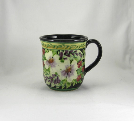 Black handmade and painted porcelain coffee cup