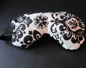 Black and White Damask Design Eye Mask, with black facial side, for sleeping, relaxing or recovering.