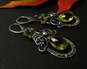 Silver dangle wire wrapped earrings with lemon quartz and grossular garnet