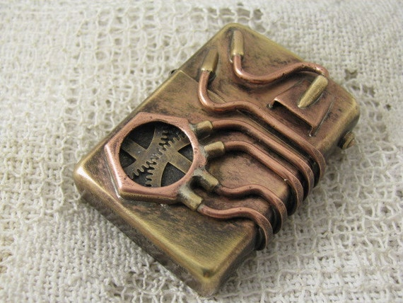 Steampunk modified Zippo windproof lighter. Made with brass, copper and vintage watch parts.