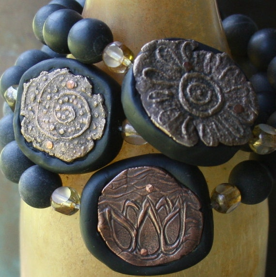SALE...not your basic black bracelet....spiral design
