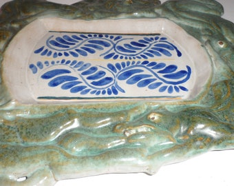 clay pottery wall hanging  or tray has alligstors or crocodiles i think could be religious  or spiritual beautiful blue green hues