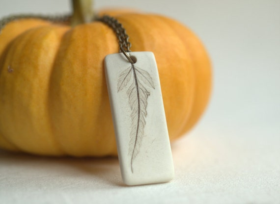 Solitary - A sweet porcelain pendant with impression of a tiny leaf.