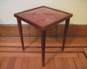 1960s vintage Mid Century Modern Orange Resin End Table with Tapered Wooden Legs