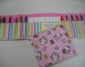 Hello Kitty Crayon Tote in a colorful print complete with 12 crayons and a paper pad