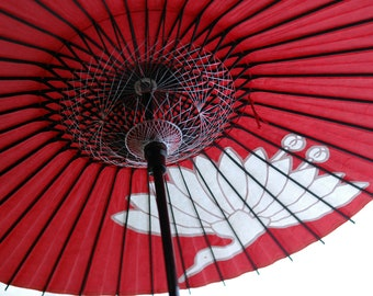 red umbrella with flowering crane