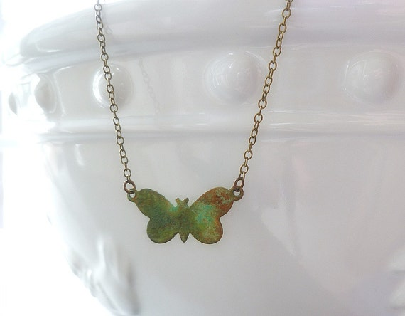Small butterfly necklace in a brass verdigris patina - minimalist style in aqua green hues on simple delicate bronze chain