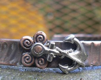 Textured copper cuff. Anchored