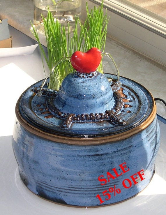 Handmade ceramic cat drinking fountain with build-in cat grass planter.