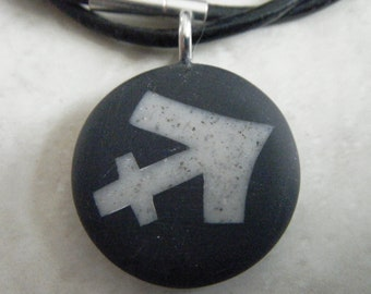 Sagittarius Zodiac signs hand carved on a polymer clay black color background. Pendant comes with a FREE 3mm necklace.