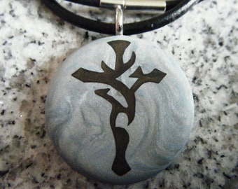 Tribal cross hand carved on a polymer clay blue marble color background.  Pendant comes with a FREE 3mm necklace