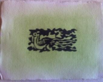 Peacock lino print on Khadi paper, pale green watercolour wash