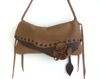 brown leather handbag messenger with braided strap, leaf fringe, and flower by Tuscada. Ready to ship