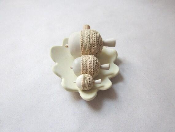 Hand sculpted acorns with a unique oak leaf bowl