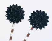 Black chrysanthemum hair slides in an ivory gift bag