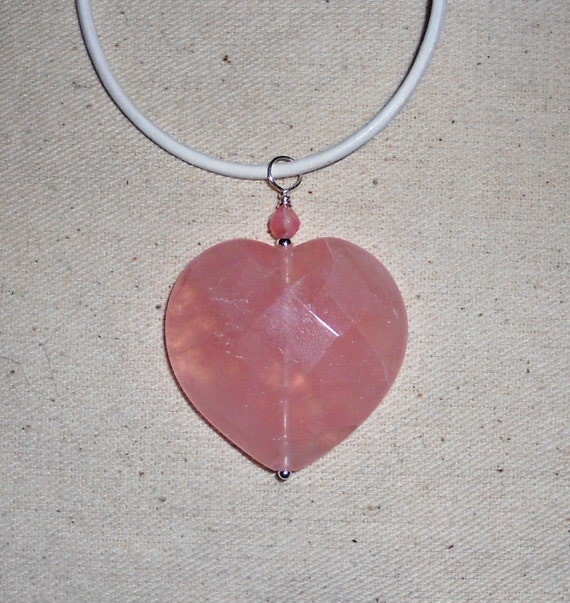 Pink faceted rose quartz heart pendant on a white leather cord semiprecious stone jewelry packaged in a colorful gauze gift bag 550A