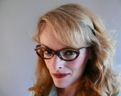 reserved / mid century tortoiseshell frame france eyeglasses / 1950s cat eye glasses / curled up with a book
