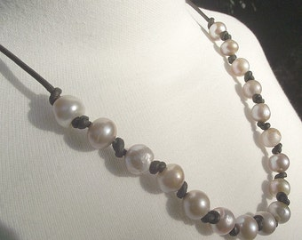 SALE Pearl necklace. Organic natural shapes. Rich dark leather and freshwater pearls.
