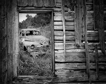 Rusted Vintage Car through the Window of a Weathered Wall in Ontario Canada shows the Ravages of Time A Fine Art Auto Landscape Photograph
