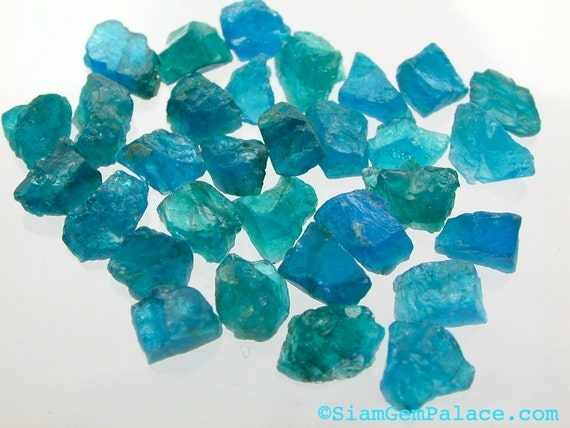 NeOn BLUE Apatite. Windex Blue  Rough Top Natural Surface.  Stud Size Elongated  Rough Form Shapes. 18 pc. 20.90 cts. 5-6 mm (AP220)