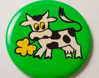 SALE 25% of  vintage metal pin, Cow with yellow flower.  Badge from USSR.
