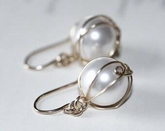 Swarovski pearl earrings wrapped in sterling silver wire