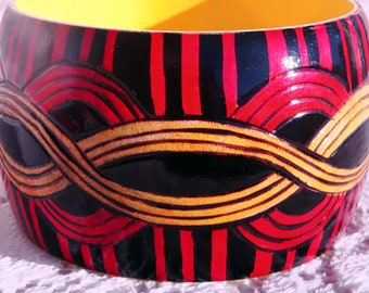 red black and yellow wood burning and painted bangle bracelet