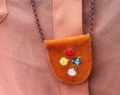 embroidered four rose suede pendant