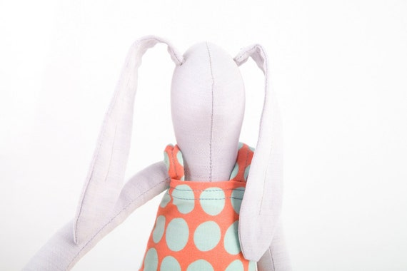 Plush Minimalist bright  lilac rabbit wearing pastel peach dress with mint polka dots, timo handmade fabric doll