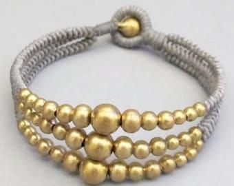 Multi Strand Brass Bead Gray Wax Cord Snake Knot Bracelet
