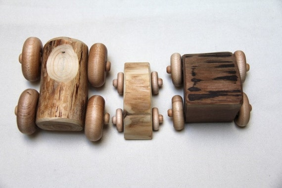 trio of woods - log racers - natural wood cars made from firewood