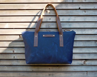 Waxed canvas bag/ carry all with  leather handles and zipper closure  COLLECTION UNISEX