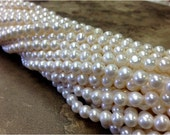 A Grade 15.5 inch Strand 6 mm Freshwater Pearl Potato Beads - White (G0905W38)
