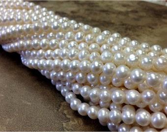 A Grade 15.5 inch Strand 6 mm Freshwater Pearl Potato Beads - White (G0905W38)