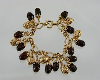 Amazing Napier Gold Tone Filigree & Dark Red Art Glass Charm Bracelet