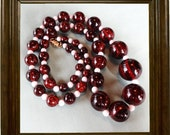 A classic Vintage single strand necklace Mahogany Brown and White
