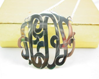 "sterling silver monogram necklace .1.5""size. with a  silver chain."