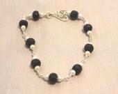 Sterling silver hand wrapped dark blue sapphire/glass pearl bracelet